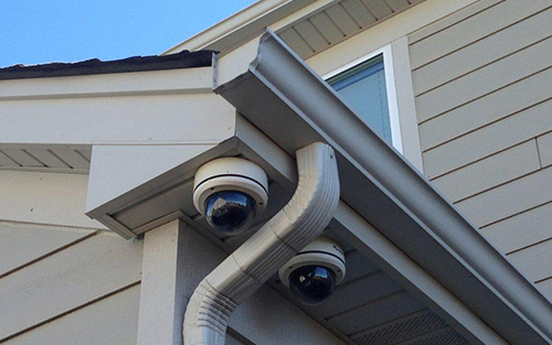 two cctv cameras installed on a house